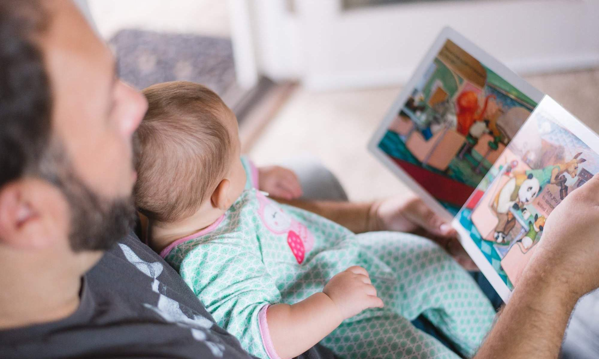 Dad reads to baby